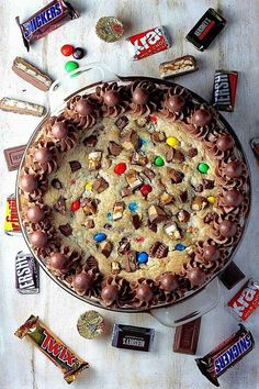What a better way to put that old Halloween candy to good use than make it into a cookie cake?