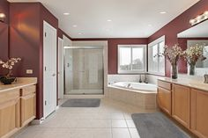 Large bathroom with walk-in shower, bathtub and gorgeous red walls - homeyou ideas Bathroom Red, Large Bathrooms, Bathroom Fixtures, Bathroom Interior, Small Bathroom, Frameless Sliding Shower Doors, Glass Shower Doors, Diy Home, Home Decor