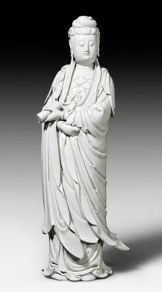 A LARGE BLANC DE CHINE FIGURE OF GUANYIN  China, 18th c. Height 78 cm. Dehua and fishermen's mark