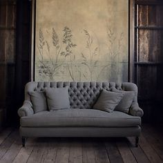I love this sofa! Such a gorgeous neutral gray. It would be the perfect touch of softness within a modern room.