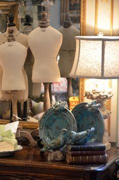 miniature manequins on display
