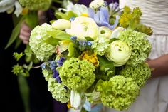 Bouquet of greens and purples and yellow. Love the hydrangeas! www.cedarwoodweddings.com