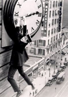 Harold Lloyd in a film still of the movie Safety Last! [directed by Fred Neymeyer and Sam Taylor, Harold Lloyd, What Is Daylight Savings, Old Film Stars, Movie Stars, Christian Marclay, Diy Blinds, Colorized Photos, Poster Prints, Art Prints
