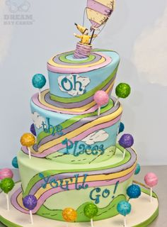 Oh, the Delicious Places You'll Go! Graduation Cakes -  Photo via Dream Day Cakes Dr. Seuss Cake: The places you'll go will be extremely sweet, if your graduation is punctuated with a cake like this! Based on the ever-inspirational Dr. Seuss stor