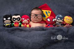 Newborn boy in Superman cape laying next to superhero stuffed animals. Superhero newborn session by Pueblo newborn photographer K.D. Elise Photography.