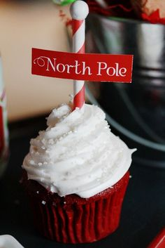 North Pole Cupcake  would be cool to use candy cane stick and marshmallow with the paper sign