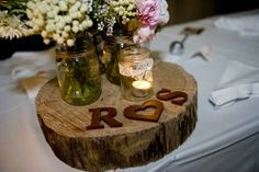 wood bases for centerpieces with mason jar vases/candles!