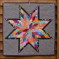 scrappy lone star mini-quilt, a scrappy version (obviously with different colors) of a single large block quilt