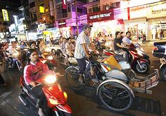 Ho Chi Minh City. This is the way it was...lots of people whizzing about the city. Didn't get to explore too much so will have to go back. Was very interesting to see how western Vietnam is in its cities.