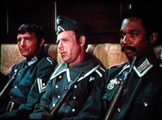 The heroes in Wehrmacht uniforms on a train bound for the Russian front.-from season 5 episode, The Klink Commandos.