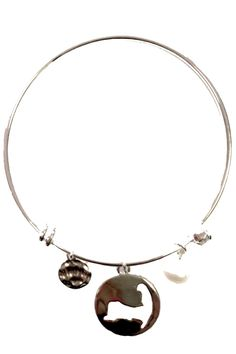 """A beautiful, simple silver bangle with a silver Cape Cod charm. Stack this bangle with other silver bangles in your jewelry box! The bangle is one size and slightly adjustable. The charm measures approximately 3/4"""" in diameter.   Silver Cc Bangle Accessories - Jewelry - Bracelets Cape Cod, Massachusetts"""