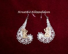 Handmade bobbin lace earrings with a snowman and a snow woman