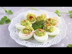 Guacamole Deviled Eggs are a healthy appetizer made with eggs, avocado, cilantro and lime juice. Loaded with a good dose of healthy fats and perfect for any