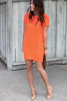 bright dress, neutral pumps, clutch and a cuff.