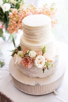 Big Sky Resort Wedding // Heidi & Dylan via Rocky Mountain Bride // white wedding cake with blush and white flowers // @wildblume_MT David Clumpner Photographer Cakes by Jenn