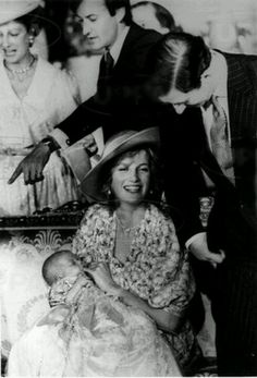 Princess Diana with William and Prince Charles at Will's christening in the Music Room at Buckingham Palace.