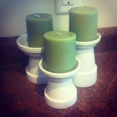 Spray paint mini terra cotta pots & saucers & glue. Classy candlesticks in minutes!