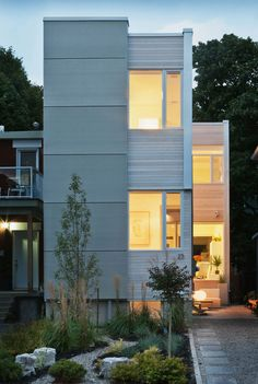 Hintonburg Home. Interesting external wood paneling or is it concrete?