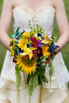 Sunflower Wedding Bouquet. I like the different textured look with the flower arrangement and the addition of the wind meals.