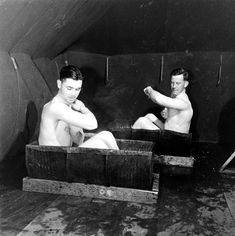 Not published in LIFE. Bathing in halved oil drums, Amchitka Island, Aleutian Campaign, Alaska, 1943.