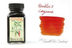 3oz (90ml) glass bottle of Noodler's Cayenne orange fountain pen ink.