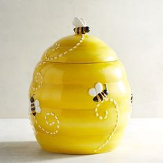 Be sweet and you might get a cookie out of our adorable beehive cookie jar. Bright yellow paint and buzzy little bees decorate the outside, making your sweets even sweeter and your countertop infinitely cuter.