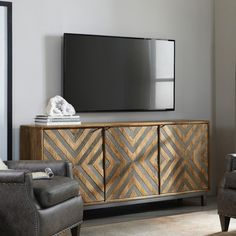A metal chevron inlay dresses up the Hooker Furniture Serramonte 69 in. Entertainment/Accent Console , making it a chic addition to any living space. Hooker Furniture, Home Office Furniture, Home Decor Kitchen, Diy Home Decor, Chevron Door, Living Room Decor, Living Spaces, Large Tv Stands, Cabinet Design