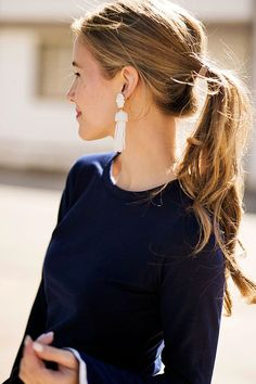 Dangle earrings and a ponytail