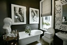 Here black walls are in complete contrast to the above bathrooms, even though there is a lot of white in this room. Description from whimsicalhomeandgarden.com. I searched for this on bing.com/images