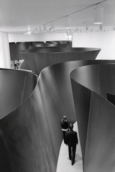The interior design titled Sequence (2006) by Richard Serra illustrates sequence as he has created a fluid, maze-like space. The metal sculpture directs people to follow the created paths and sequentially view the art.