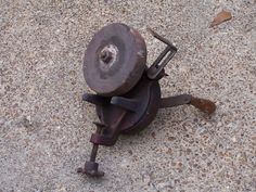 This is a Merit brand bench mount tool grinder. There is a clamp for portability. Tool rest. The crank and wheel both turn. All is in working