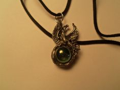 Dragon pendant with Green glass marble by SisterCraftings on Etsy