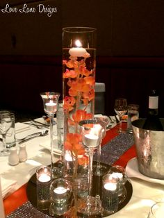 Orange and charcoal grey themed wedding centrepieces