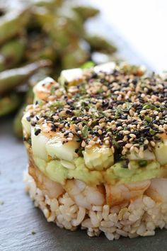 These EASY shrimp stacks will satisfy your sushi craving, and they taste SO GOOD! Layered with cucumber, avocado, shrimp and brown rice, then topped with a spicy mayo – YUM!  You don't need any fancy