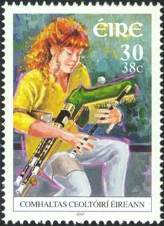 Here's another pretty stamp, dated 2001, with an Irish Uilleann pipe. We particularly like the depiction of the piper as both a young person and a woman - this would have been pretty much unheard of not so long ago, but now reflects (and encourages) the ongoing revival of this fabulous instrument. (from Ireland)
