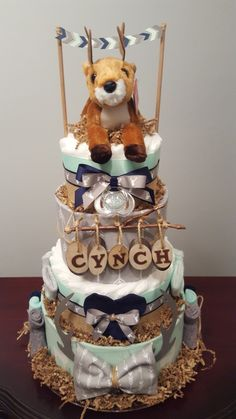Woodland Deer diaper cake. Woodland themed baby shower. Over 75 diapers included! Check out my Facebook page Simply Showers for more pics and orders. Thank you! Kim