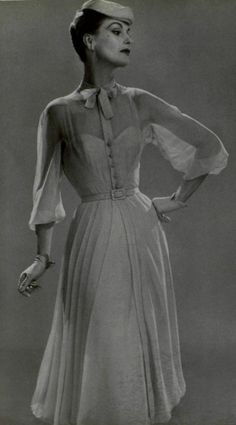 Dress with buttons and sheer detail in 1944. This sheerness is coming back in style today. The right bodice shoes of the feminine figure very nicely. The detail of the buttons down the front is my favorite. 2-23-17 colette smith