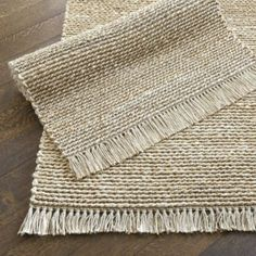 Twisted Rope Jute Rug | Ballard Designs - I'm afraid the girls would just use this as a large scratching pad.