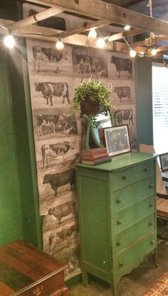 green vintage dresser pairs up with cow wallpaper panel at Pioneer Goods Co