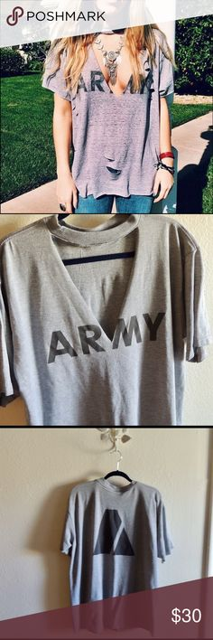Vintage Army oversized T-shirt with deep V-neck Army T-shirt with deep V-neck detail. can be distressed as shown in the first picture. LF used for search reasons only. Four of the shirts available!                               Still available!!! NAVY: Size XL. Fits true to size. Distressed. Image 4&5  SOLD ARMY: Size M. Fits true to size. Distressed. Image 6&7  One still available!!! 2 ARMY: Size L. Fits true to size. Optional distressing images 2,3, & 4 LF Tops Tees - Short Sleeve