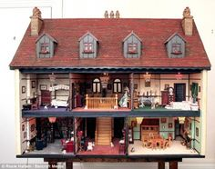 A doll house from UK fetches $82,000 This breathtaking dolls house is about to sell for £50,000 -the price of several real homes on the UK property market – after winning the heart of an overseas collector. The tiny 10-bed mansion, with its own servants' quarters, a music room with grand piano, a hand-crafted games room with snooker table and a library with over 1,000 separately bound books, took Peter Riches a painstaking 15 years to complete.