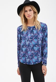 Vibrant prints are a go-to when you're looking to bring new life to your collection of office attire. This billowy blouse features an abstract-watercolor print that is sure to offset tired bottoms and muted hues. Light pleating along the round neckline and a buttoned keyhole back are the sophisticated touches that finish this long-sleeved piece. We suggest letting it stand on its own and keeping accessories to a minimum.