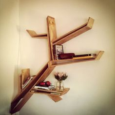 Hanging branch bookshelf. A little different from ones I've seen before, but love it. Should be an easy DIY.