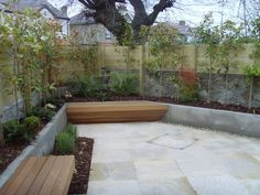 Wood benches and concrete planters...would love to landscape our courtyard like this