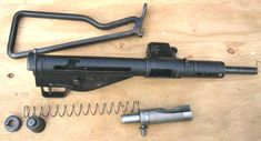 Sten MK II partially disassembled to show the bolt and return spring.