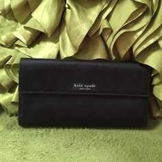 """BEAUTIFUL VINTAGE $250 DESIGNER KATE SPADE WALLET BEAUTIFUL VINTAGE $250.00 PLUS TAX, DESIGNER KATE SPADE NYLON WALLET, FULL SIZE MEASURES: 7.6"""" INCHES BY 4.4"""" INCHES. THIS IS THE OLDER TIMELESS MODEL, NO SIGNS OF WEAR. MATCHES EVERYTHING, CLASSIC CLEAN BLACK COLOR. •••PRICED TO SELL, ALL REASONABLE OFFERS WELCOME THROUGH THE OFFER OPTION, NO TRADES OR HOLDS••• kate spade Bags Wallets"""