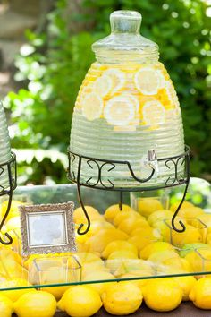 I like the idea of working lemons into the decor- we had lemon trees growing up and it reminds me of family vacations in Italy as well.        ...         Photography by mirellecarmichael.com, Floral Design by jennymcnieceflowers.com