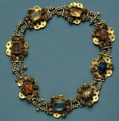 The Saint Queen Necklace. 14th Century. Necklace in Gold, safires, imperial…
