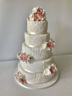 A beautiful wedding cake decorated with a lace brocade design and pearls laceweddingcakes weddingcakes blushwedding pinkwedding vintageweddingcake vintagecakes 572097958915456795 Fancy Wedding Cakes, Elegant Birthday Cakes, Wedding Cake Rustic, Wedding Cake Decorations, Elegant Cakes, Beautiful Wedding Cakes, Wedding Cake Designs, Wedding Cake Toppers, Wedding Cakes With Cupcakes