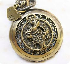 alice rabbitbirdiesclock golden dial pocket watch by touchsoul. $9.99, via Etsy.